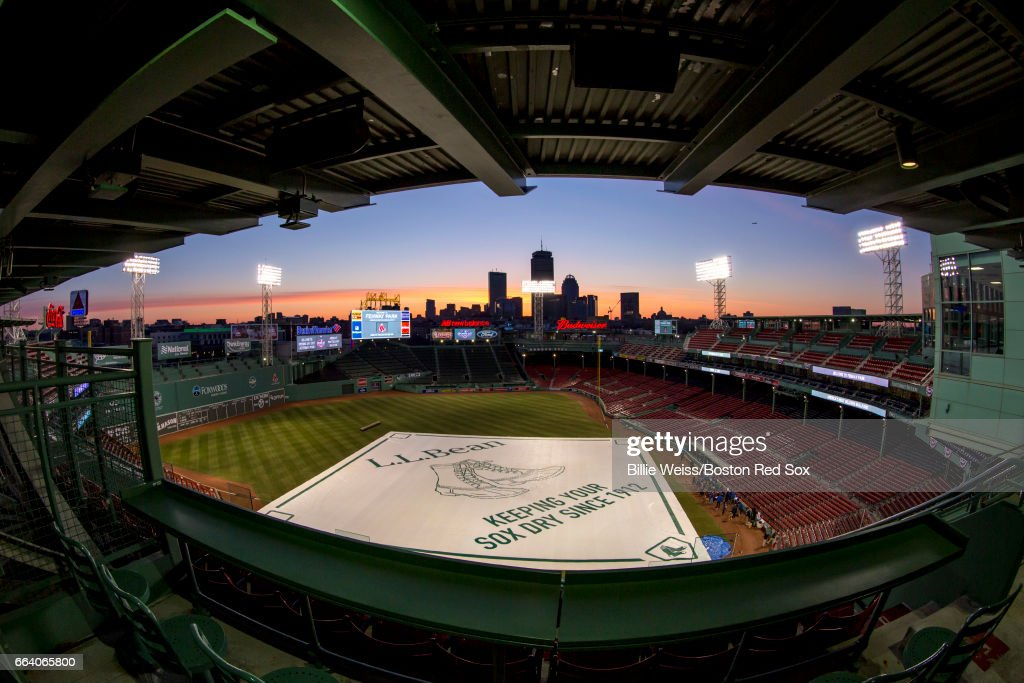 The sun rises over Fenway Park before the Boston Red Sox home opener against the Pittsburgh Pirates on April 3, 2017 at Fenway Park in Boston, Massachusetts .