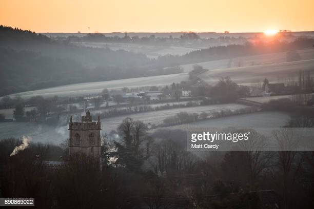 The sun rises over fields close to the village of Wellow on December 12 2017 near Bath England Last night the UK had the coldest night of the year...