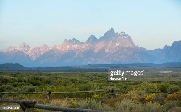The sun rises over Grand Teton National Park on August 21 2017 outside Jackson Wyoming Thousands of people have flocked to the Jackson and Teton...