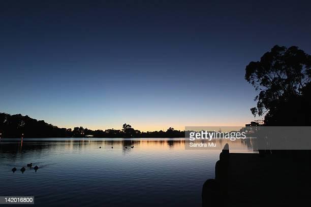 The sun rises over Hamilton Lake during a hot air balloon dawn lift on March 29 2012 in Hamilton New Zealand Each Autumn over 30 hot air balloons...