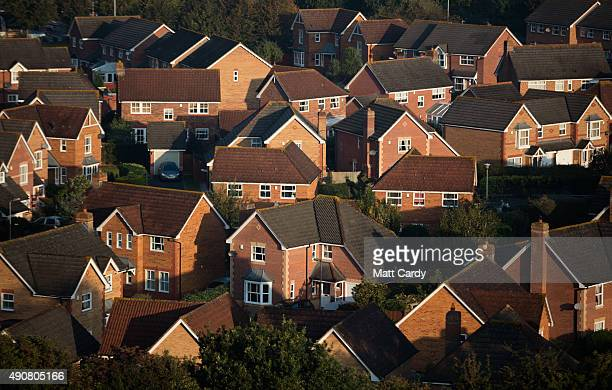 The sun rises over houses in a housing estate on October 1 2015 in Glastonbury England The fine autumn weather that some parts of the UK have...