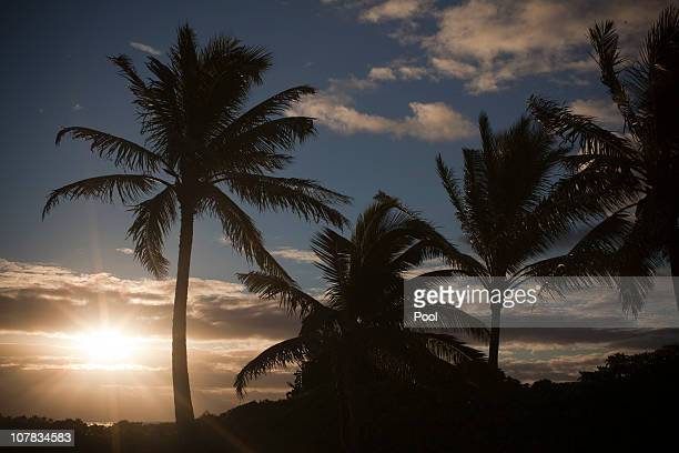 The sun rises over Kailua Beach near US President Barack Obama's vacation compound in Kailua Hawaii December 31 2010 The Obama's are on an 11day...