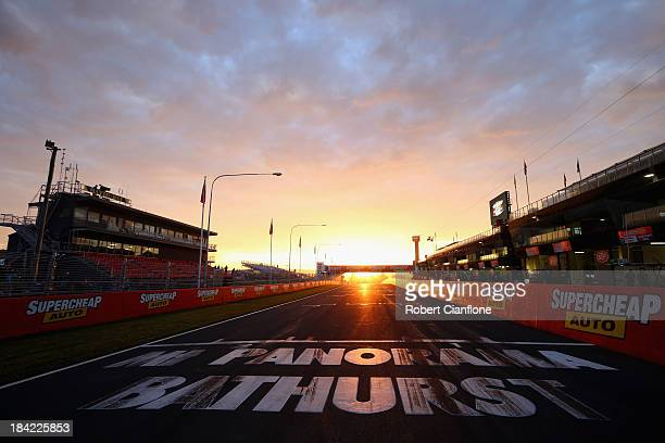 The sun rises over pit straight prior to the Bathurst 1000 which is round 11 of the V8 Supercars Championship Series at Mount Panorama on October 13...