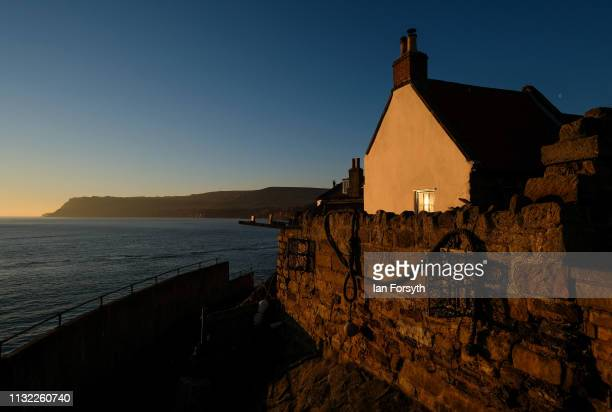 The sun rises over Robin Hood's Bay on February 26 2019 in Robin Hood's Bay England Warm weather continues to sweep the country as the warmest winter...