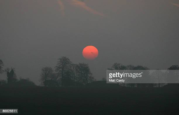 The sun rises over Stonehenge as druids celebrate the Spring Equinox at Stonehengeon March 20 2009 near Amesbury Wiltshire England Several hundred...