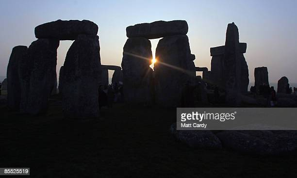 The sun rises over Stonehenge as druids celebrate the Spring Equinox at Stonehenge on March 20 2009 near Amesbury Wiltshire England Several hundred...