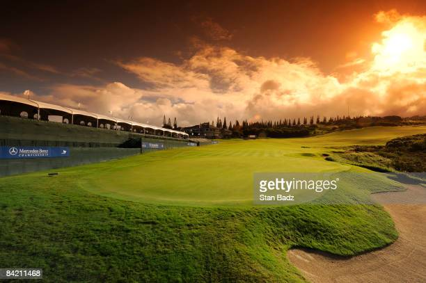 The sun rises over the 18th hole during the first round of the Mercedes-Benz Championship held at Plantation Course at Kapalua on January 8, 2009 in...
