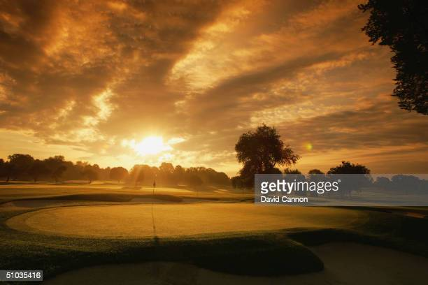The sun rises over the 7th green on the South Course at the Oakland Hills CC venue for the 2004 Ryder Cup Matches, on June 14, 2004 in Detroit,...
