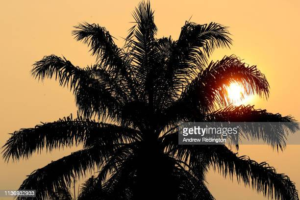The sun rises over the course during the Pro Am event prior to the start of the Maybank Championship at the Saujana Golf Country Club Palm Course on...