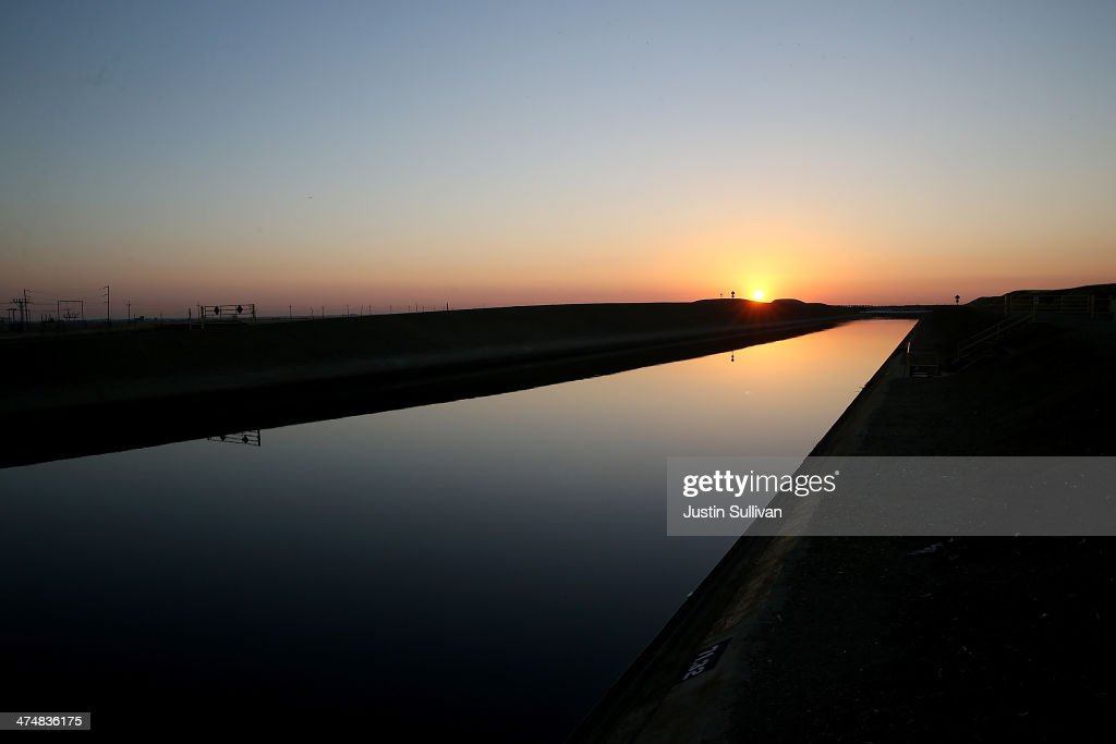 The sun rises over the Delta-Mendota Canal on February 25, 2014 in Los Banos, California. As the California drought continues and farmers struggle to water their crops, the U.S. Bureau of Reclamation officials announced this past Friday that they will not be providing Central Valley farmers with any water from the federally run system of reservoirs and canals fed by mountain runoff.