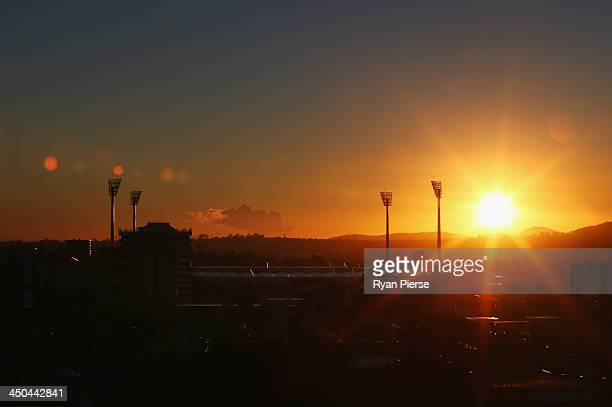 The sun rises over The Gabba before an Australia nets session at The Gabba on November 19, 2013 in Brisbane, Australia.