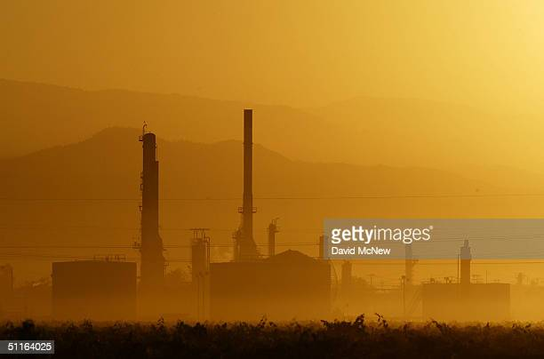 The sun rises over the Kern Oil and Refining Co refinery on August 12 2004 near the town of Lamont southeast of Bakersfield California High levels of...