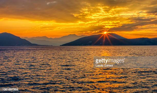 The Sun rises over the Kotor Bay on October 23 2018 in Njivice Montenegro