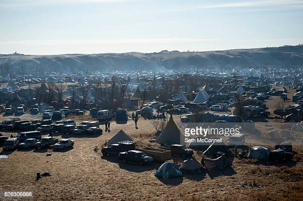 The sun rises over the Oceti Sakowin Camp on the Standing Rock Sioux Reservation in Canon Ball North Dakota on November 26 2016
