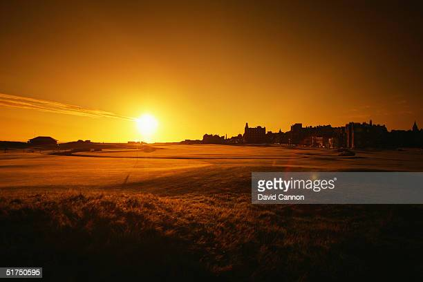 The sun rises over the RA Clubhouse and the 1st and 18th holes on the Old Course at St Andrews venue for the 2005 Open Championship on August 21 2004...
