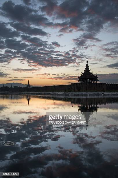 The sun rises over the royal palace in Mandalay on November 29 2013 AFP PHOTO / FRANCOIS XAVIER MARIT