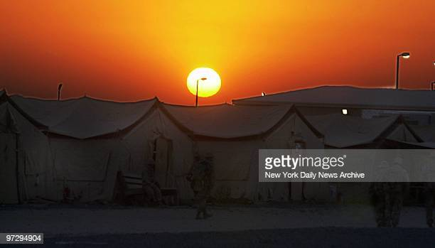 The sun rises over the tents of Navy Seabees on Al Jaber Air Base in the Kuwait desert American troops and equipment are massed in Kuwait in...