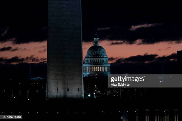 The sun rises over the US Capitol and National Mall on December 22 2018 in Washington DC Democrats refused to agree with President Donald Trump's...