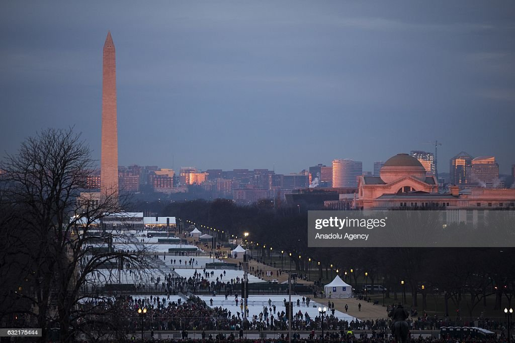 The sun rises over the Washington Monument and National Mall as people begin to arrive for the 58th U.S. Presidential Inauguration where President-elect Donald Trump will be sworn in as the 45th President of the United States of America in Washington, USA on January 20, 2017.