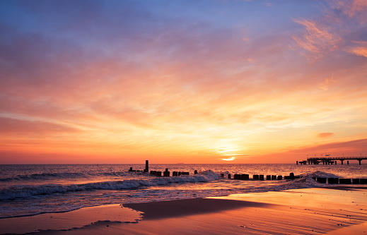 The sun rising at the beach in the morning 117146356