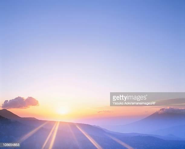 The Sun Rising Over a Mountain Range. Hachimantai, Iwate Prefecture, Japan