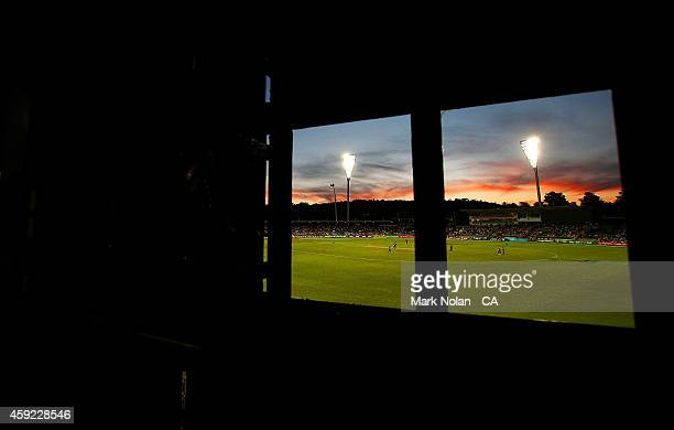 The sun set over Manuka Oval is pictured from the score board during game three of the One Day International Series between Australia and South...