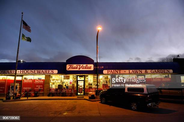 RANGELY CO DECEMBER 5 The sun sets above the brightly lit True Value hardware store on December 5 2017 in Rangely Colorado This small northwestern...