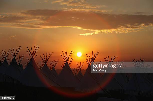 The sun sets above the tipi field as music fans start to arrive at the Glastonbury Festival site at Worthy Farm, Pilton on June 24, 2009 in...
