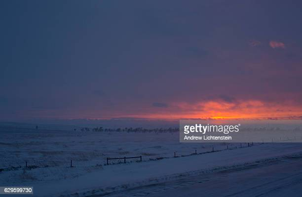 The sun sets after a winter blizzard descends on the camp Just outside of the Lakota Sioux reservation of Standing Rock, North Dakota, where over two...