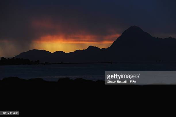 The sun sets after the days rain during the FIFA Beach Soccer World Cup Tahiti 2013 Group B match between Solomon Islands and El Salvador at the...