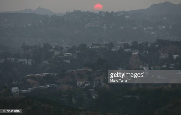 The sun sets amid smoke from wildfires on September 13, 2020 in Los Angeles, California. Air quality was deemed 'unhealthy for sensitive groups' in...