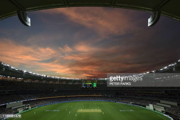 The sun sets as Australia play New Zealand on day one of the first Test cricket match between Australia and New Zealand at the Perth Stadium in Perth...