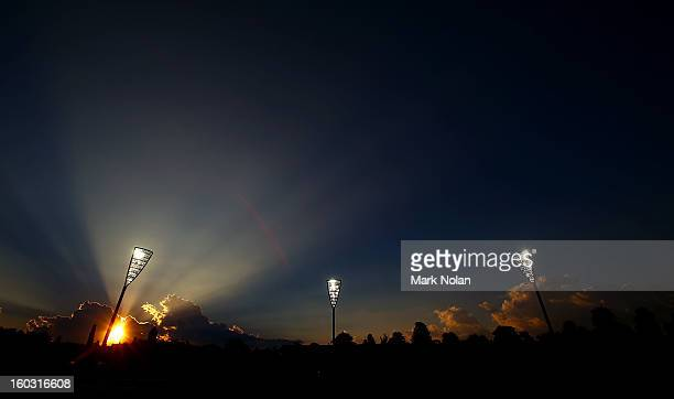 The sun sets as Manuka Oval hosts cricket under lights for the first time during the International Tour Match between the Prime Minister's XI and...