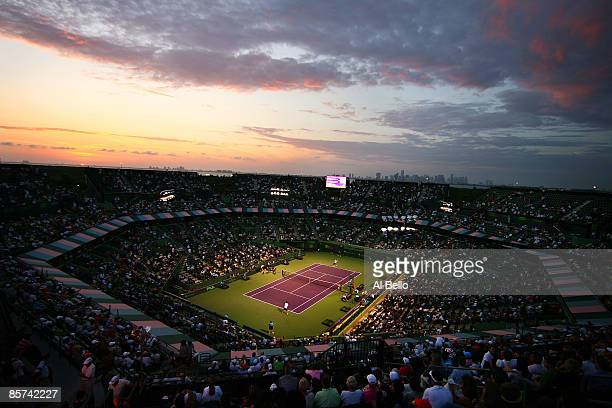 The sun sets as Roger Federer of Switzerland takes on Taylor Dent during day nine of the Sony Ericsson Open at the Crandon Park Tennis Center on...