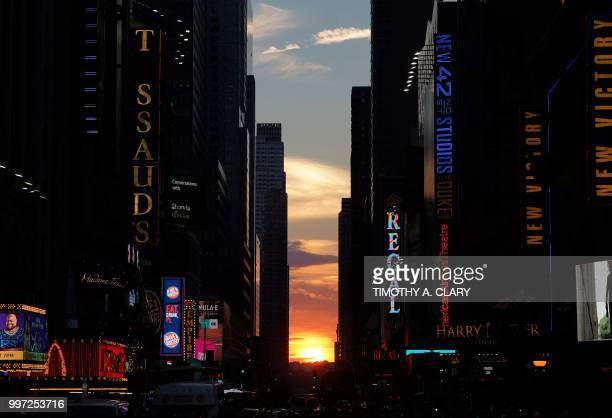 TOPSHOT The sun sets as seen from 42nd street in Times Square in New York City on July 12 2018 during Manhattanhenge Manhattanhenge sometimes also...
