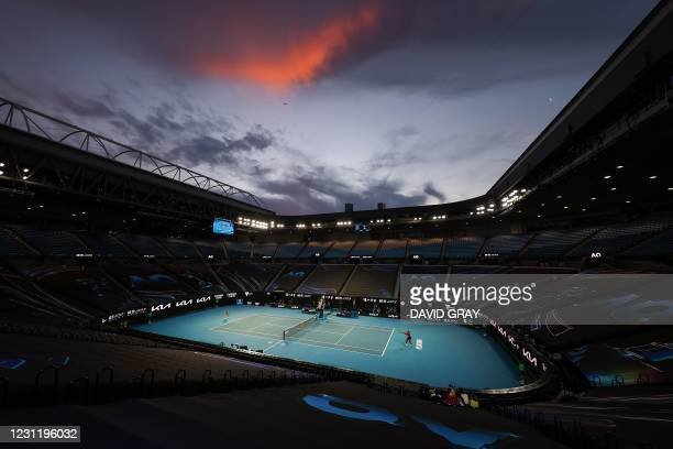 The sun sets as Serena Williams of the US hits a return against Romania's Simona Halep during their women's singles quarter-final match on day nine...