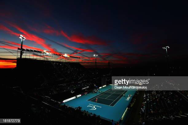 The sun sets as Shingo Kunieda of Japan plays against Stephane Houdet of France in the Mens Wheelchair Gold Medal match on day 10 of the London 2012...