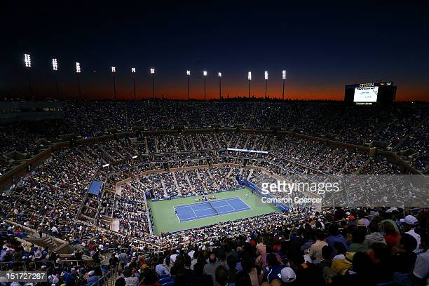 The sun sets as spectators inside Arthur Ashe Stadium watch the men's singles final match between Andy Murray of Great Britain and Novak Djokovic of...