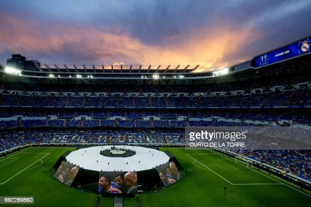 The sun sets as the crowd start to gather in the tribune before a celebration event held at the Santiago Bernabeu stadium after the team won the the...