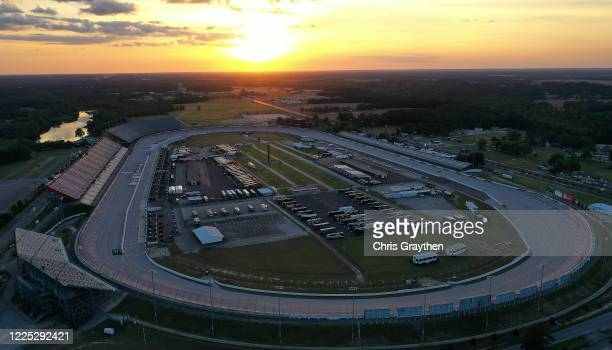 The sun sets at Darlington Raceway on May 16 2020 in Darlington South Carolina NASCAR is preparing to resume the season with a race tomorrow after...