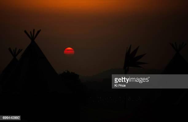 The sun sets at Glastonbury Festival Site on June 21 2017 in Glastonbury England