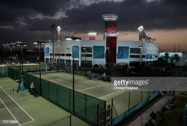 The Sun sets at the Khalifa Tennis Stadium during the 15th Asian Games Doha 2006 at Khalifa International Tennis and Squash Complex on December 4,...
