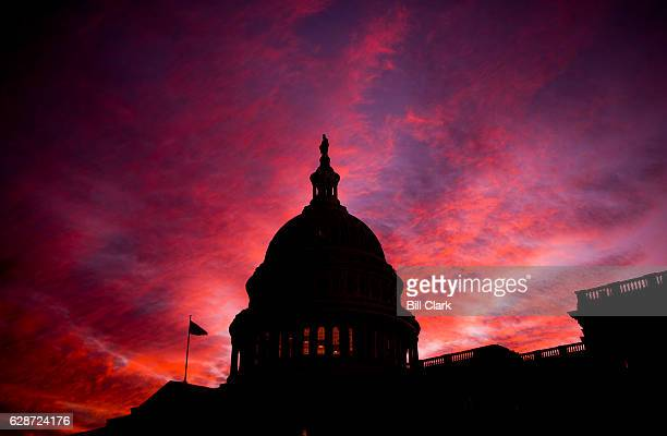 The sun sets at the US Capitol as the 114th session of Congress comes to a close on Thursday Dec 8 2016 The House passed spending bill to fund the...