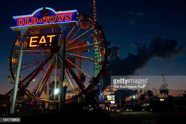 The sun sets behind a ferris wheel at Old Town in Kissimmee, Florida. The Latino vote could be decisive in swing states such as Florida. The majority...