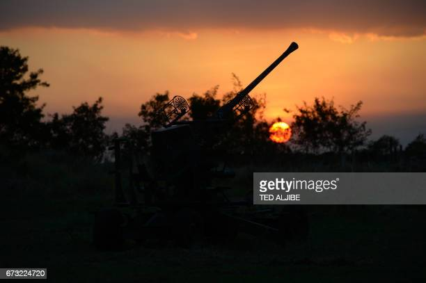 The sun sets behind an antiaircraft gun placed near the venue of the Association of Southeast Asian Nations summit in Manila on April 26 2017...