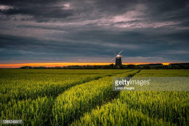 The sun sets behind Burnham Overy windmill in Norfolk.