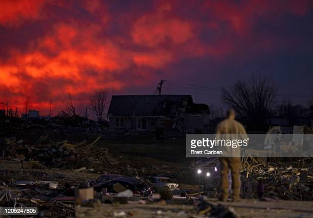 The sun sets behind damaged homes left after a tornado early Tuesday morning on March 4 2020 in Cookeville Tennessee A tornado passed through the...