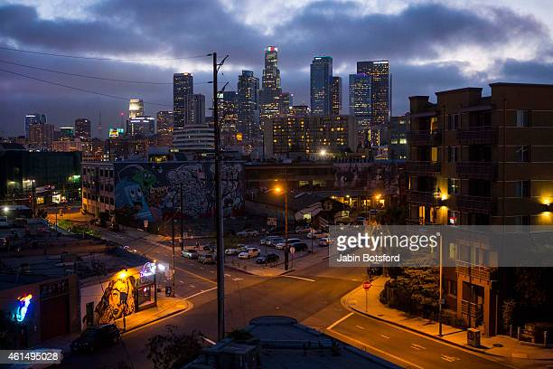 The sun sets behind downtown as Bloom's Square Triangle is seen at the corner of Traction Avenue and East 3rd Street on July 01 2014 in Los Angeles...