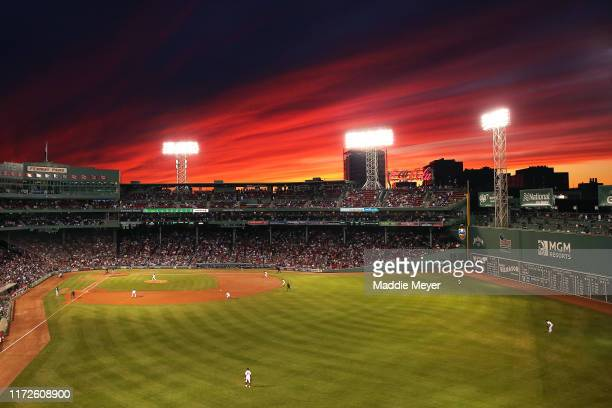 The sun sets behind Fenway Park during the second inning of the game between the Boston Red Sox and the Minnesota Twins on September 05, 2019 in...