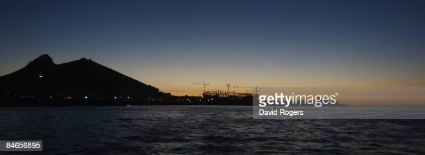The sun sets behind Green Point Stadium under construction on January 29 2009 in Cape Town South Africa The stadium will host the semi finals of the...
